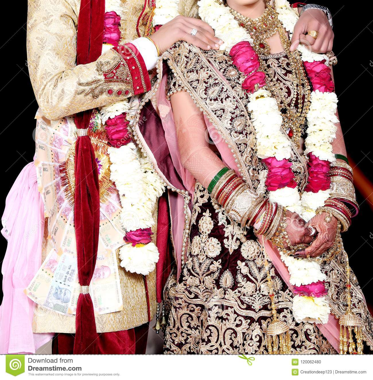 Indian Bride And Groom Pose For Beautiful Portraits After Their Colorful Jaimala Ceremony Stock Photo Image Of Marriage Colorful 120062480