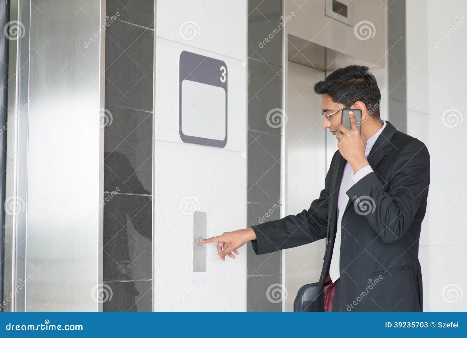 Indian Businessman Entering Elevator Stock Photo Image
