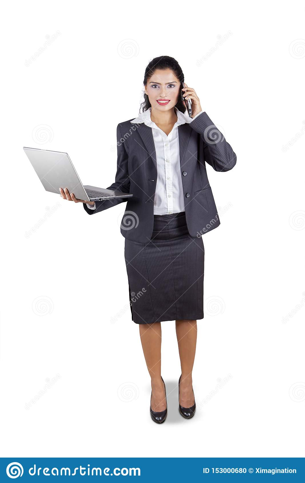 Indian businesswoman with laptop and phone