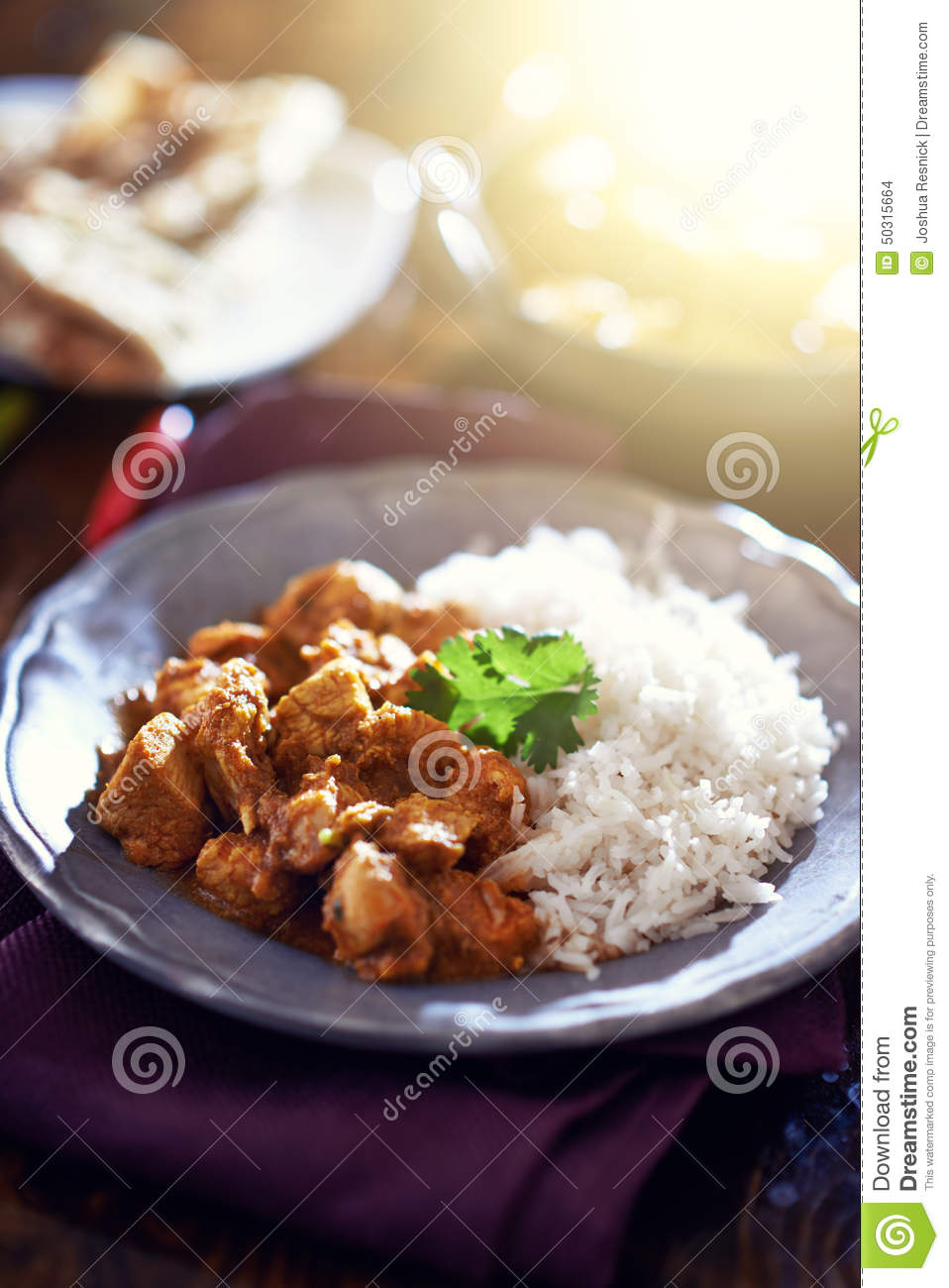 Indian butter chicken curry with basmati rice.