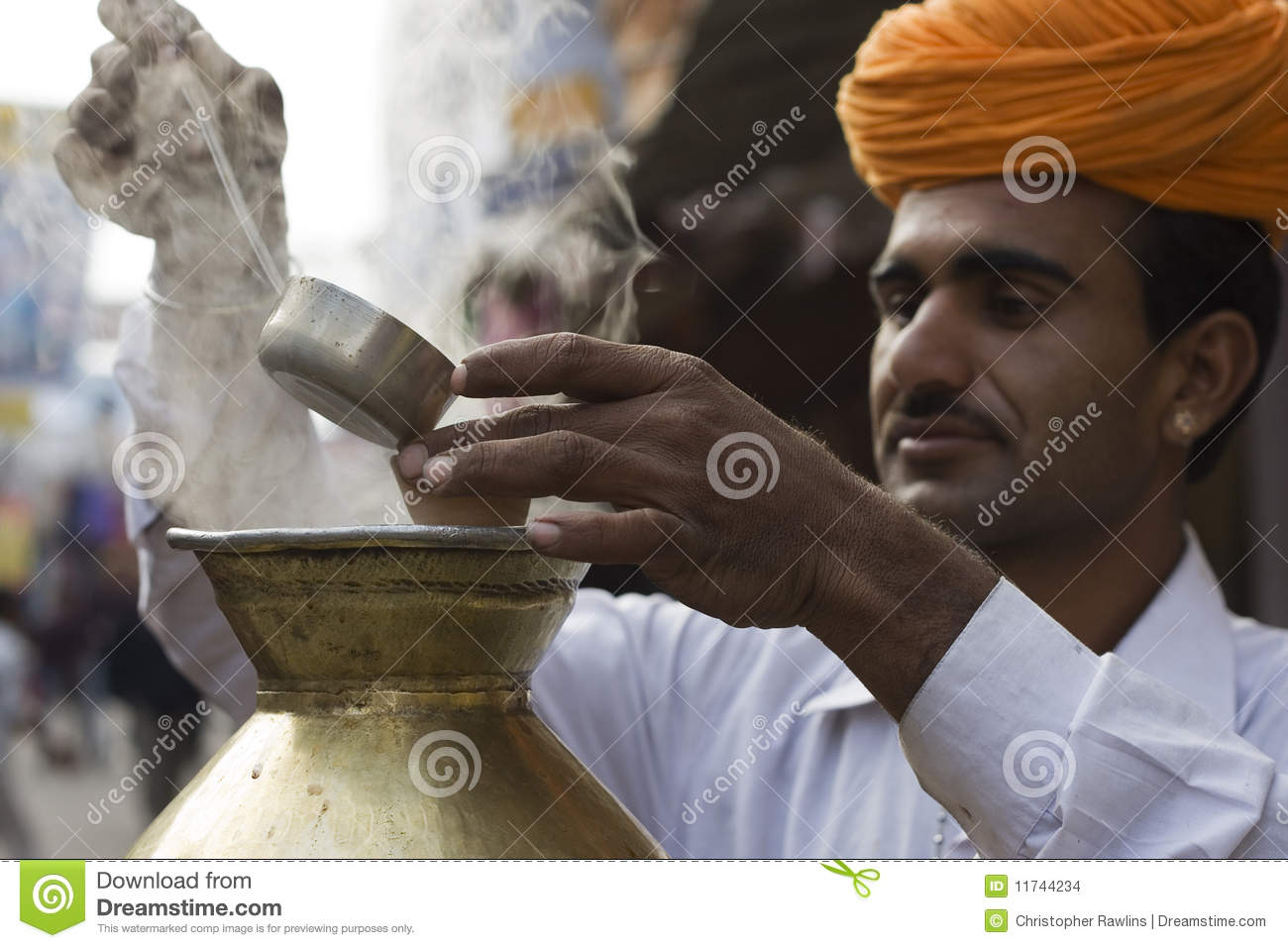 Indian Chai Worker pouring some Tea