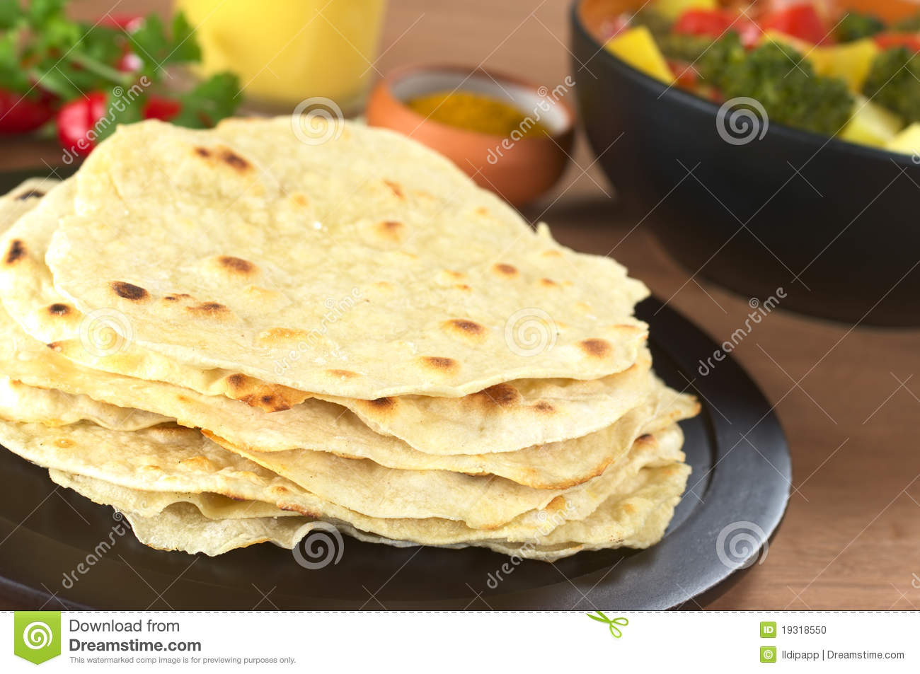 Indian flat bread called Chapati with vegetable curry, curry and mango ...