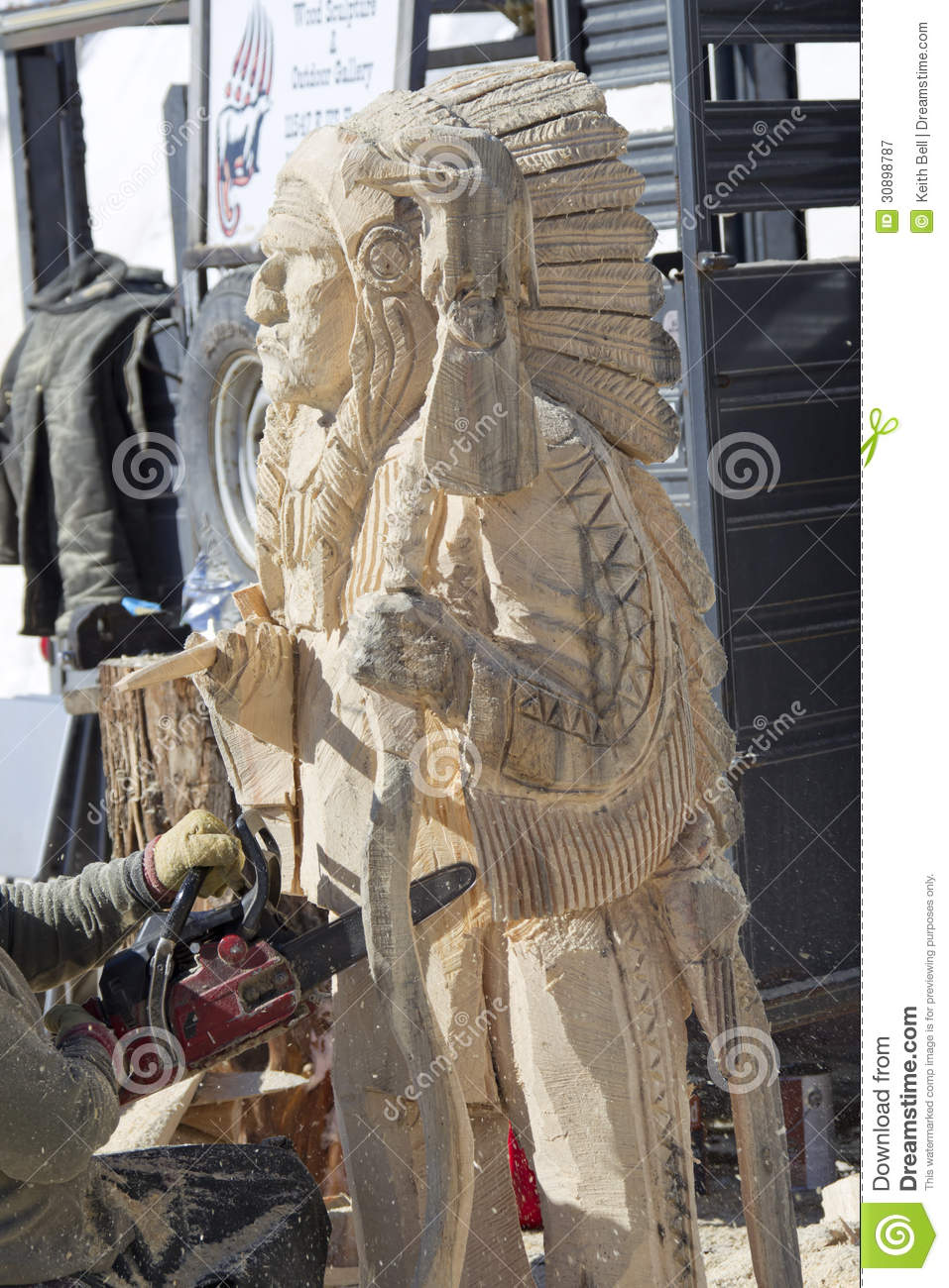 Indian chief chainsaw carving editorial photography