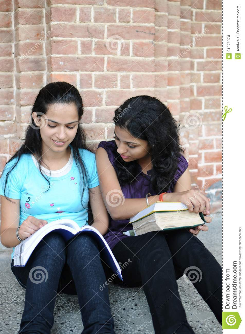 indian college girls doing combined study. stock photo - image of