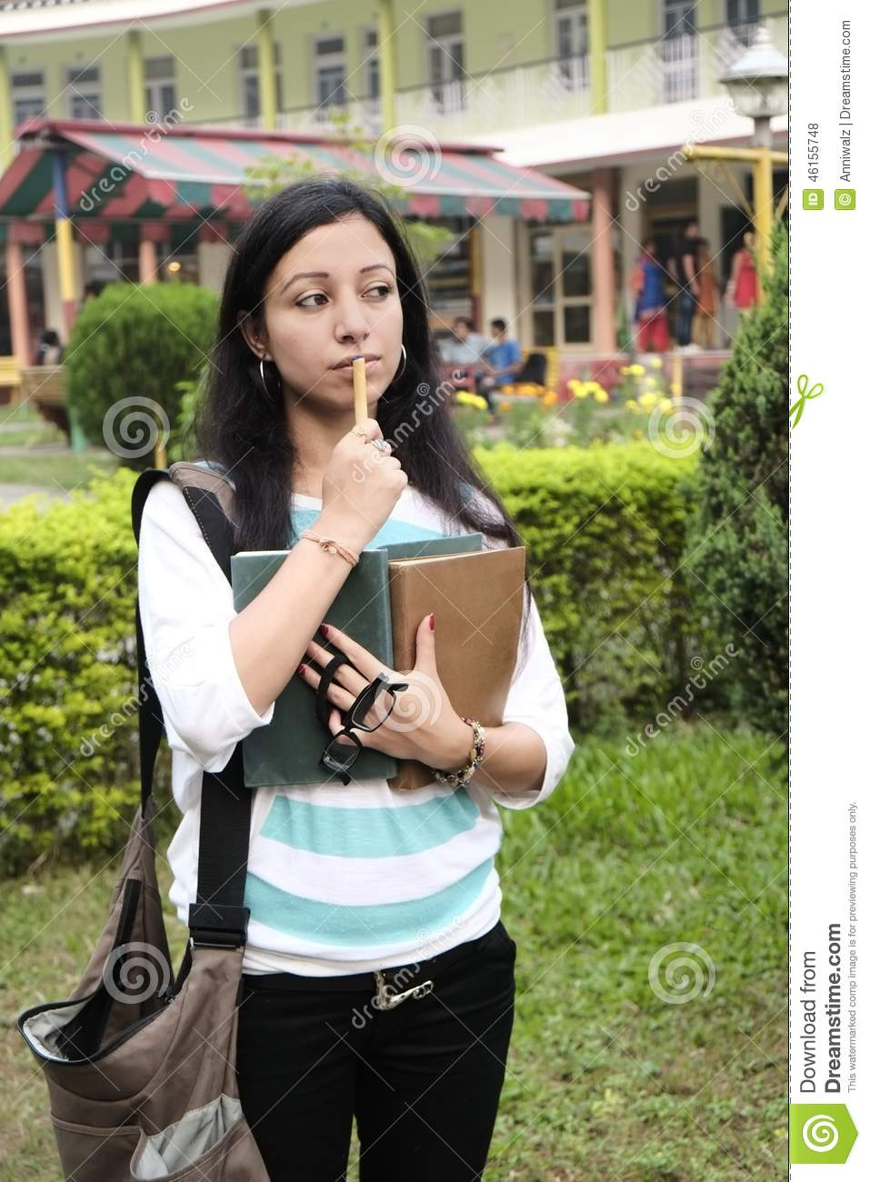 indian college student is busy thinking stock photo - image of