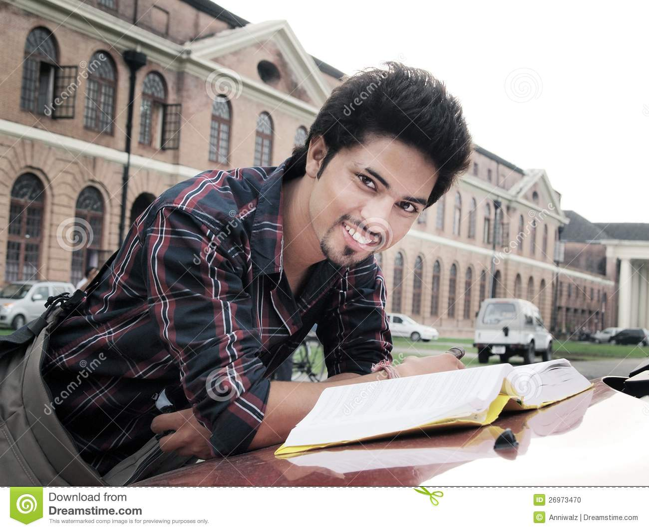 Indian College Student Reading Book. Stock Photo - Image ...