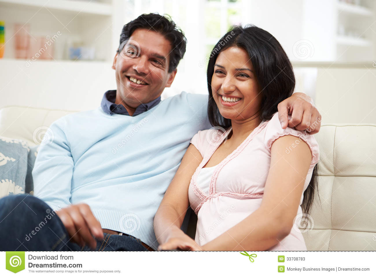 Indian Couple Sitting On Sofa Watching TV Together Stock  : indian couple sitting sofa watching tv together arm over shoulder 33708783 from dreamstime.com size 1300 x 957 jpeg 111kB