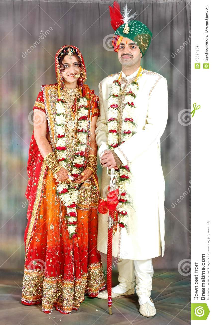 Indian Couple In Their Wedding Dress Stock Photo - Image of makeup ...