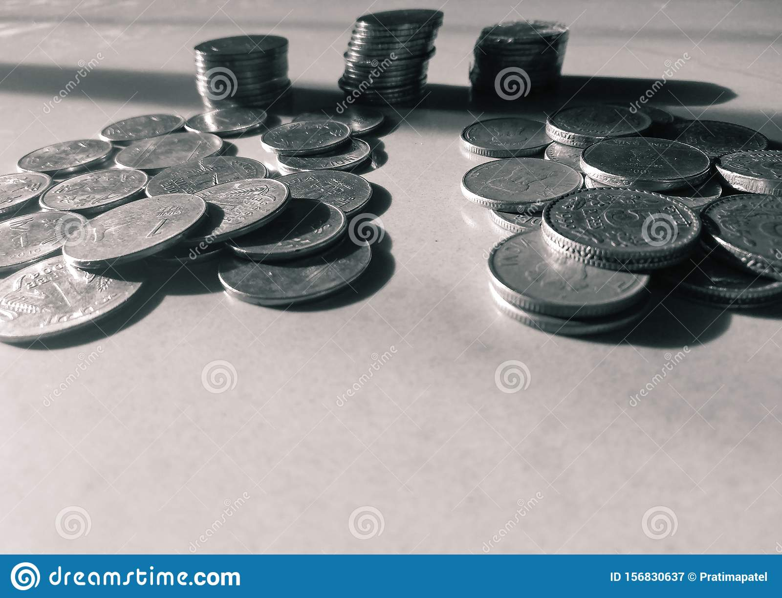 Indian currency coins in a white marble background
