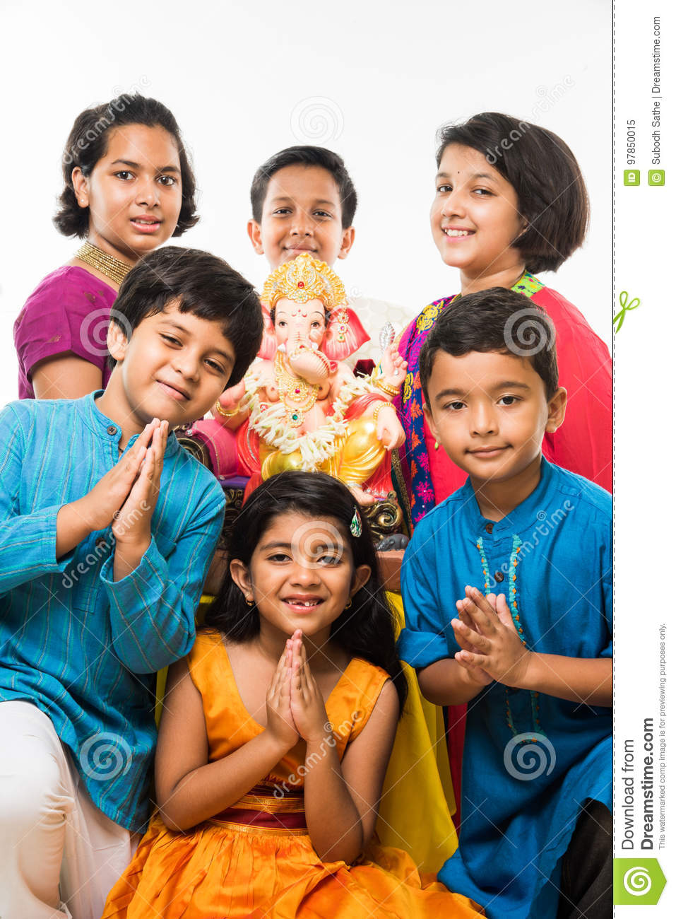 indian cute kids holding statue of lord ganesha or ganapati on