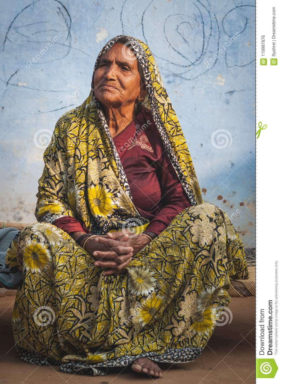 Indian elder in tradition clothing sitting down