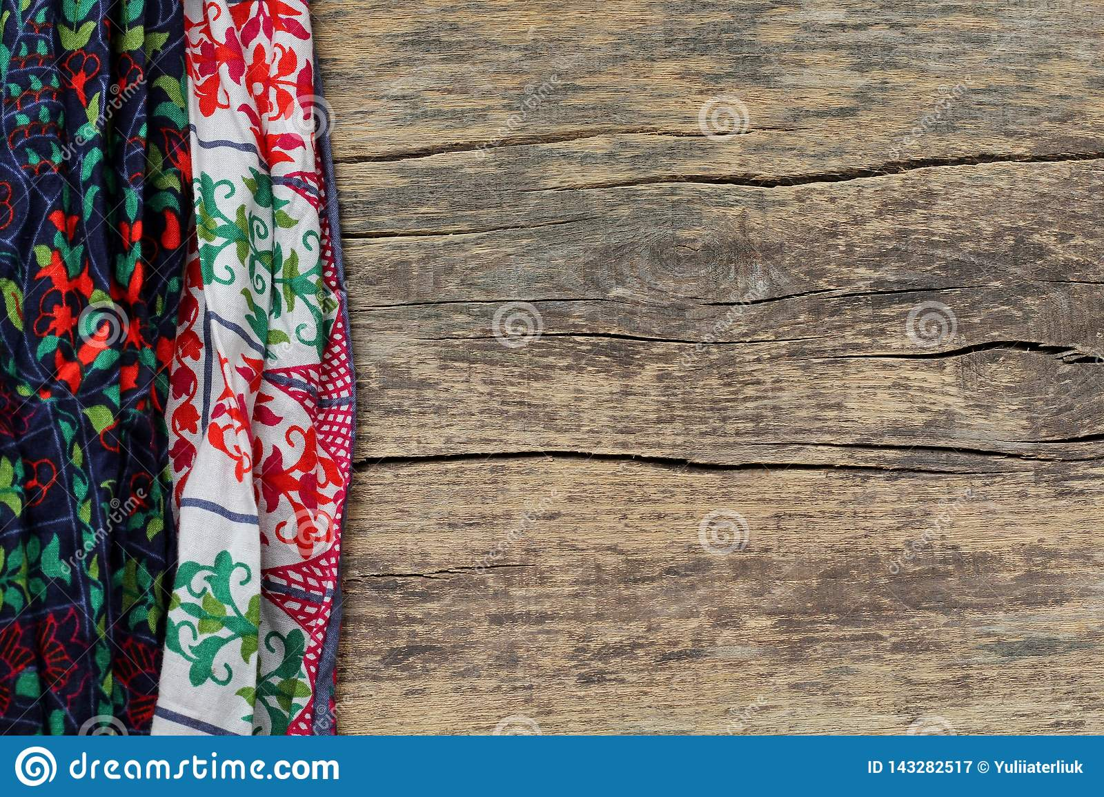 Indian ethnic colored fabric on a wooden background