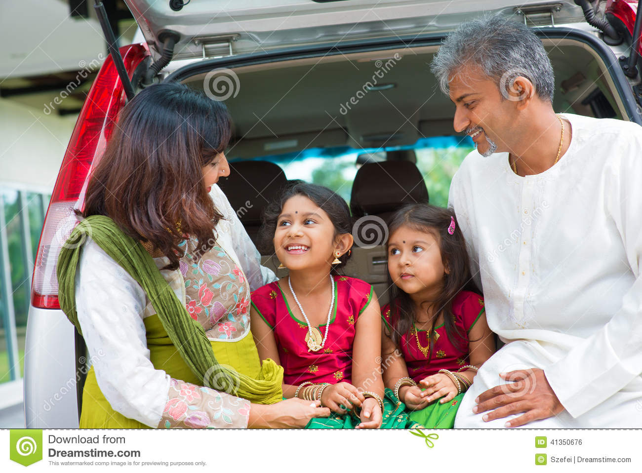 Indian Family In Car Infront New House. Stock Photo ... Happy Asian Family In Front Of House