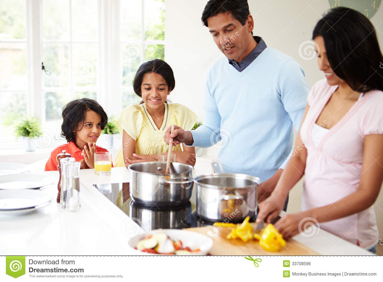 Indian Family Cooking Meal At Home Royalty Free Stock