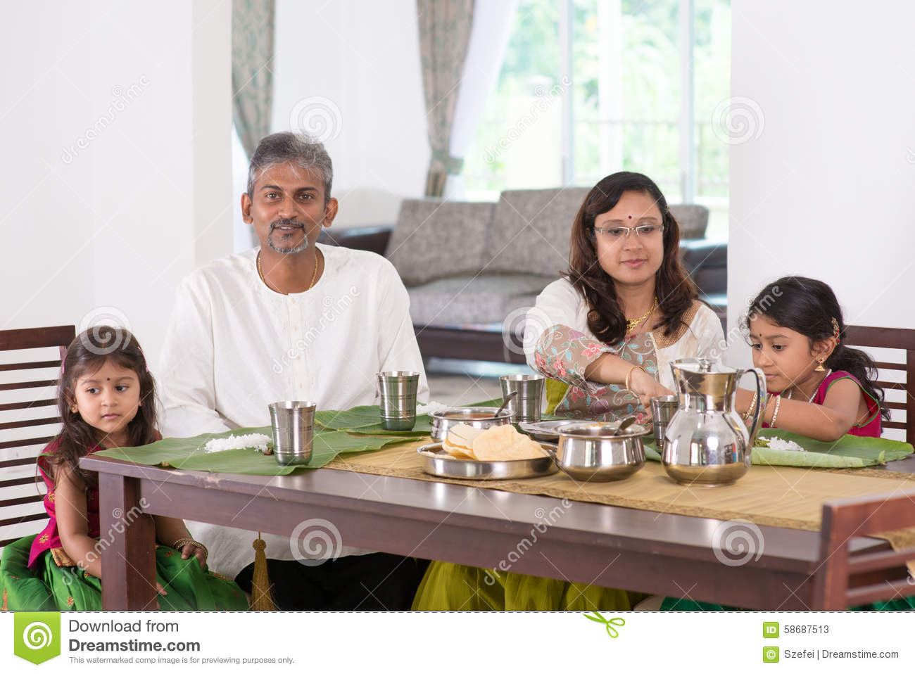 Indian family dining at home stock image image 58687513 for Eating table