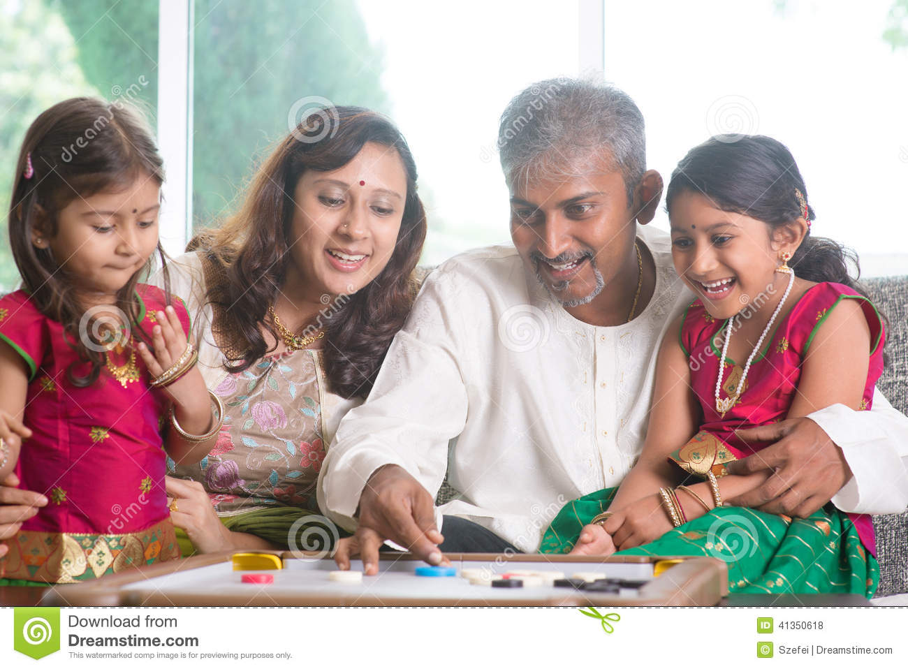 indian family playing carrom game stock photo image. Black Bedroom Furniture Sets. Home Design Ideas