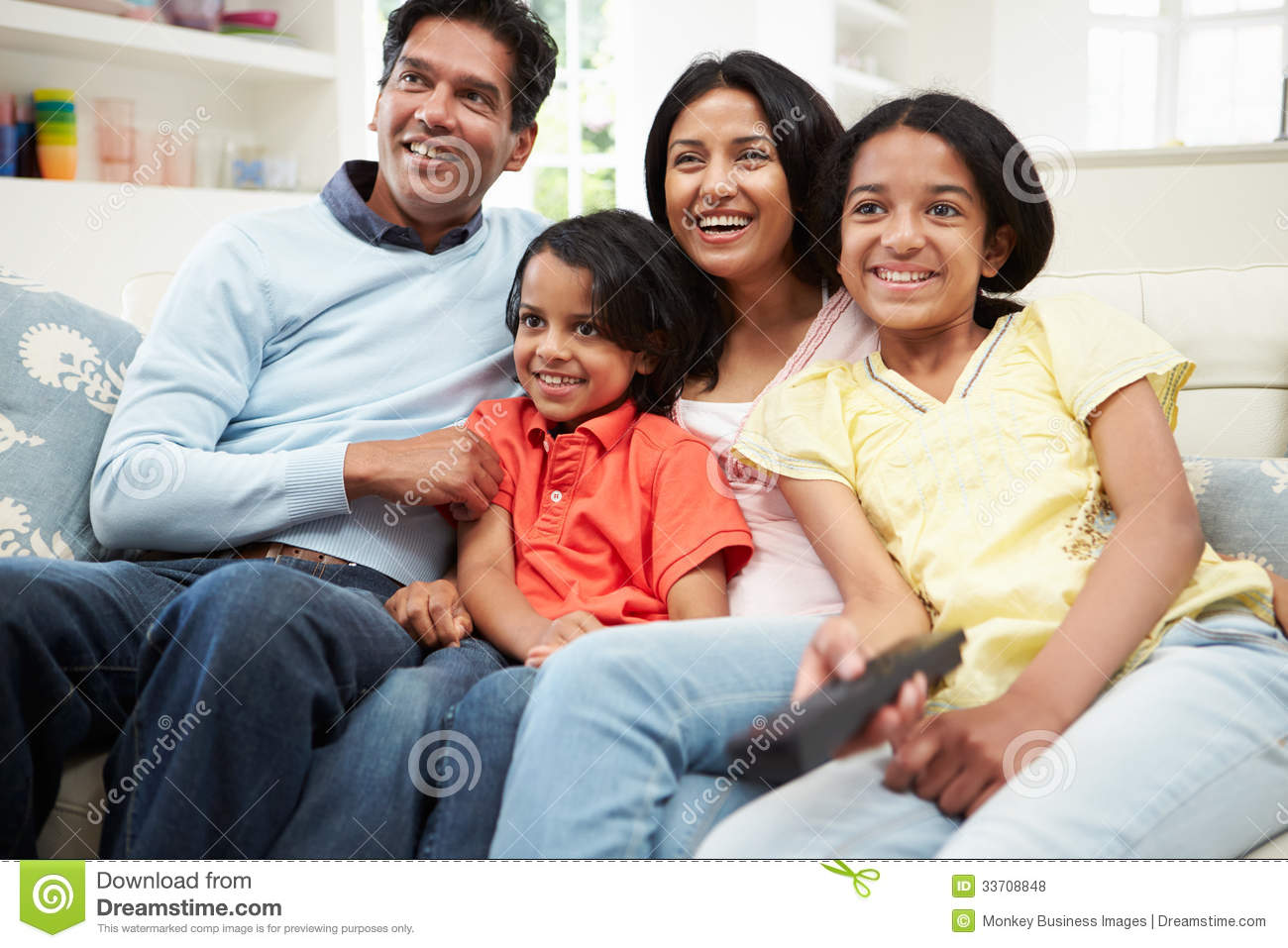 Indian Family Sitting On Sofa Watching TV Together Royalty  : indian family sitting sofa watching tv together looking away camera smiling 33708848 from www.dreamstime.com size 1300 x 957 jpeg 141kB