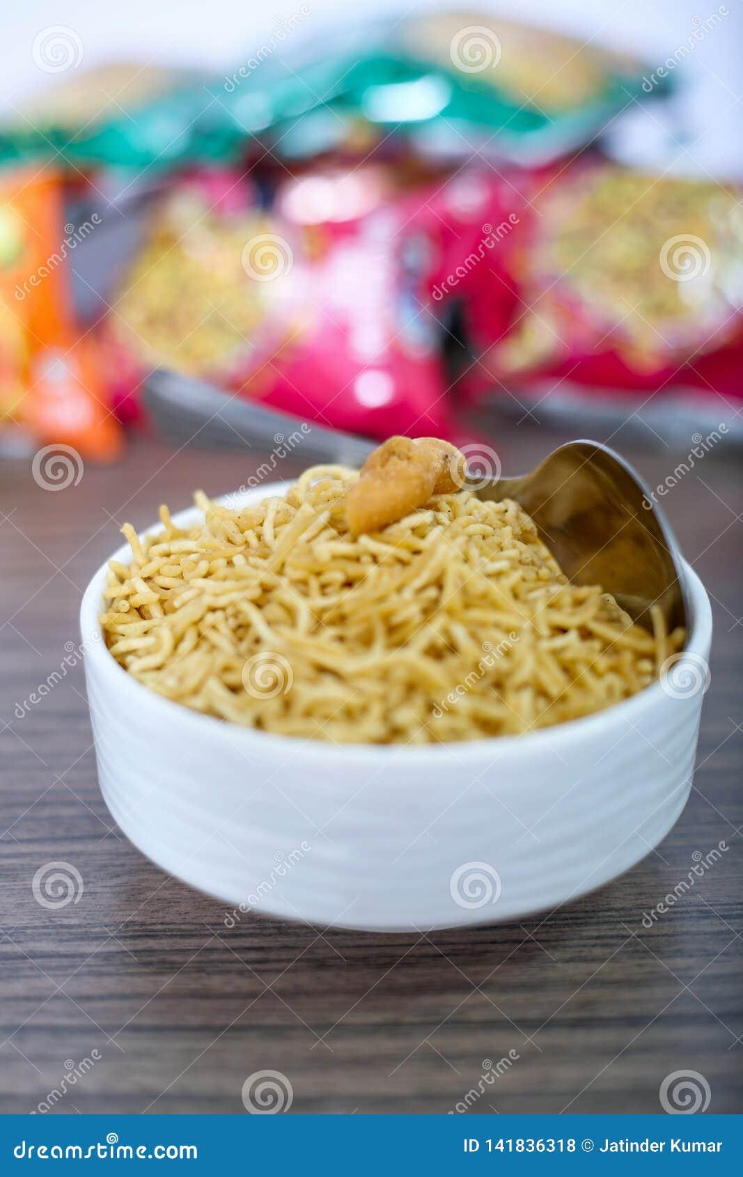 Indian famous bikaneri namkeen bhujia in the bowl with spoon