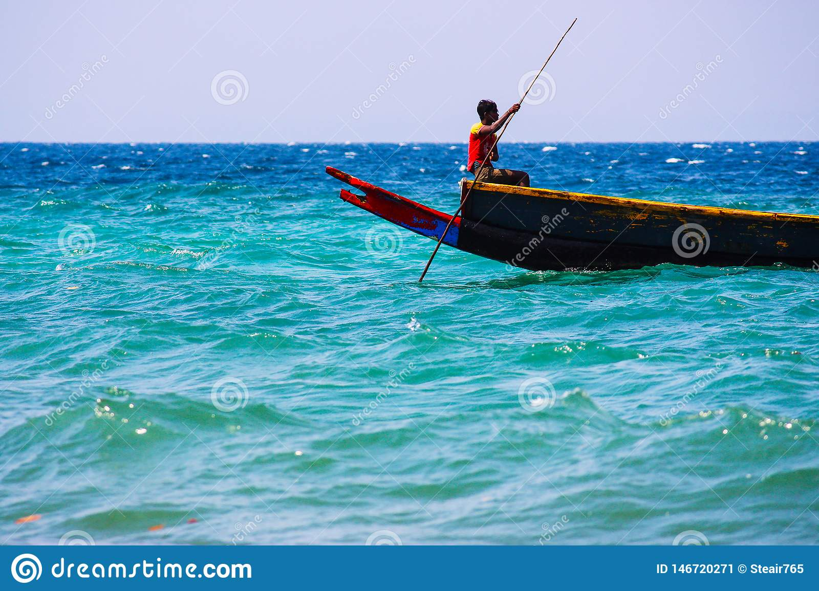 Indian fisherman on his boat in the sea