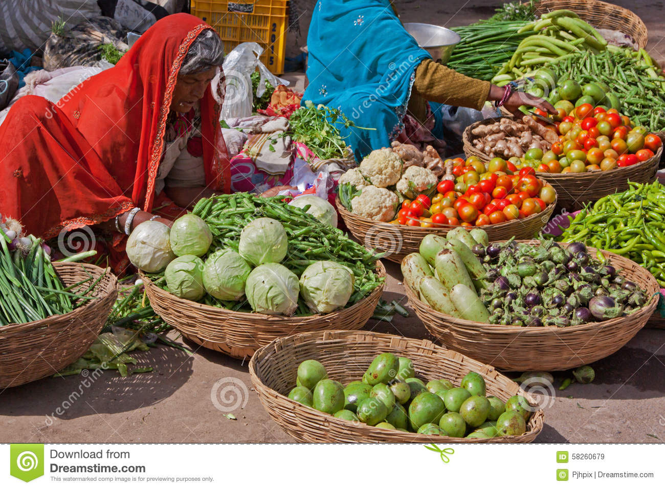 Deogarh India  city photos : DEOGARH, INDIA – MARCH 8, 2015: Women selling fruit and vegetables ...