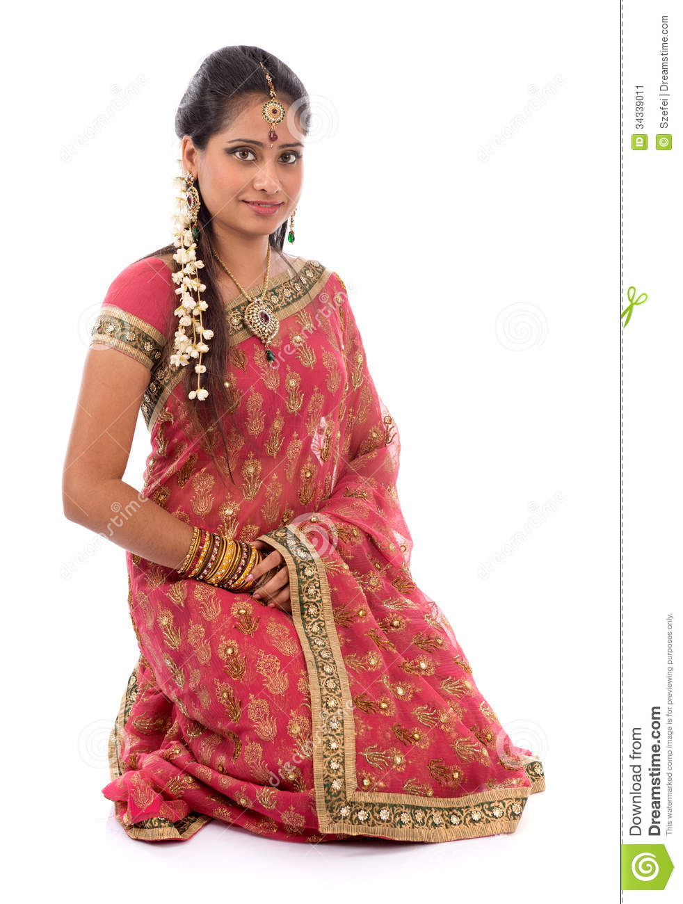 724f916800 Portrait of full body traditional Indian girl in sari clothes smiling,  kneeling on floor isolated on white background.