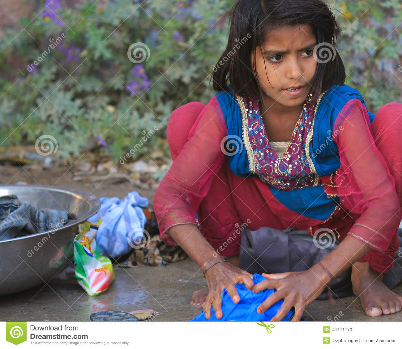 BAGH, INDIA, FEBRUARY 28: An unidentified girl washing clothes by hand ...