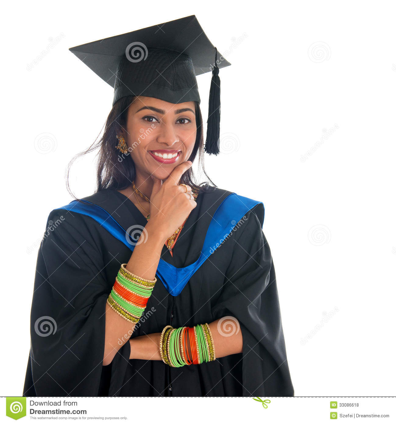 29dfc9bfa12 Happy Indian university student in graduation gown and cap thinking.  Portrait of mixed race Asian Indian and African American female model  standing isolated ...