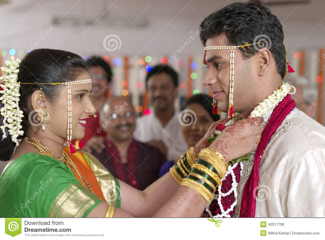 Indian Hindu Bride Looking At Groom And Exchanging Garland
