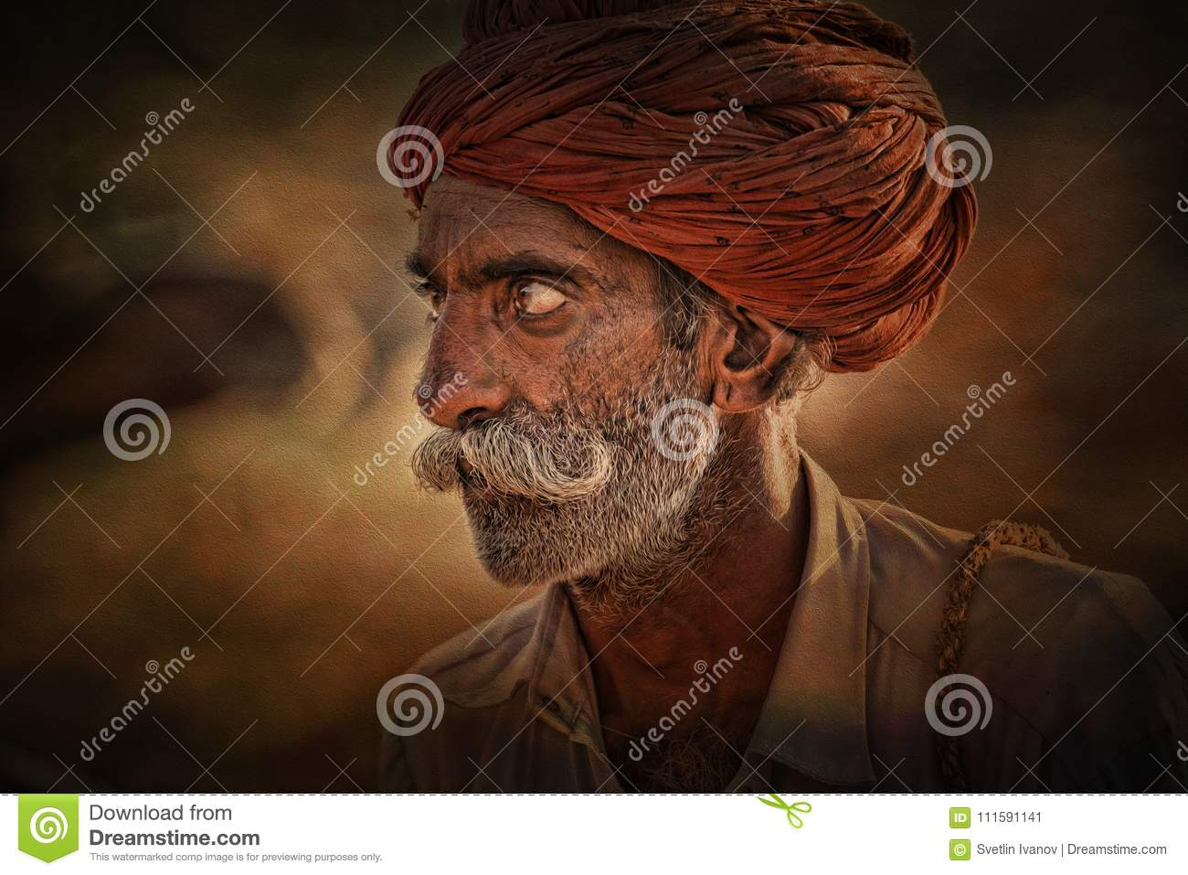 Old Rajasthani man against the background of his camels
