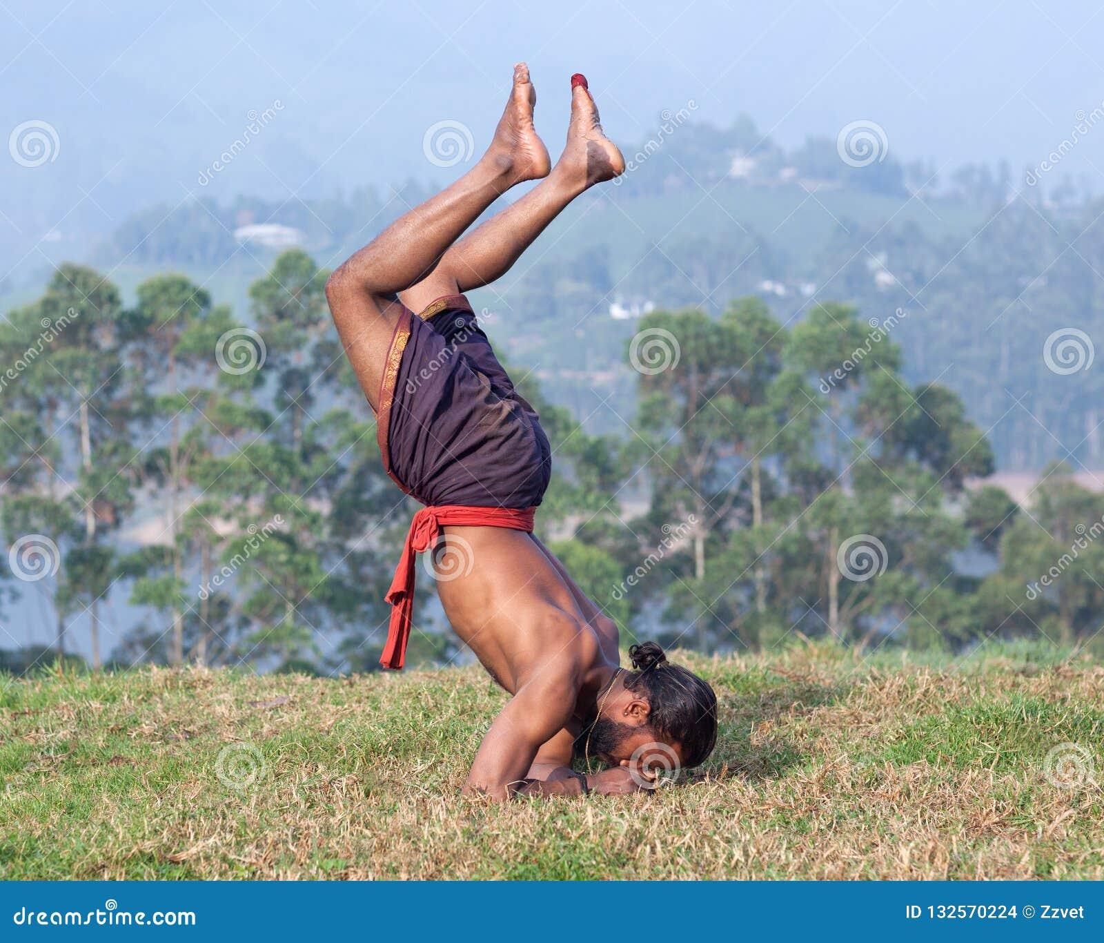 Indian Man Doing Yoga Exercises In Kerala India Stock Photo Image Of Exercises Fitness 132570224