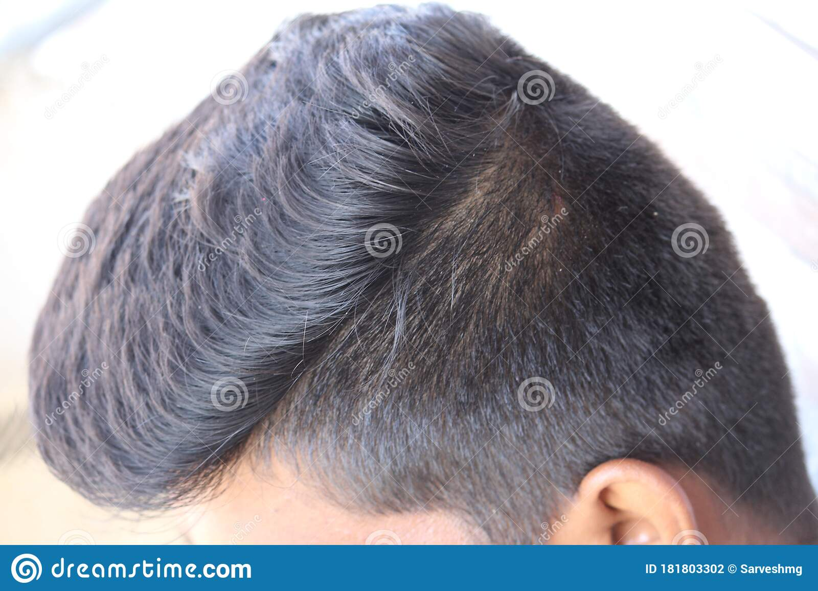 an indian man hair style in close up. beautiful silky shine