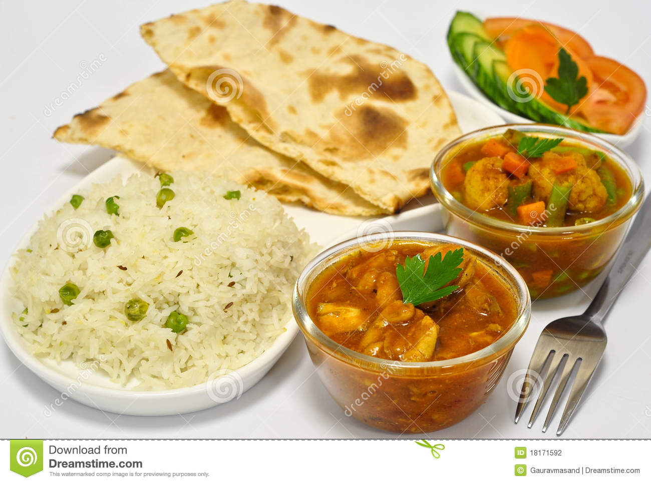 Indian meal consisting of chicken curry as the main dish, along with