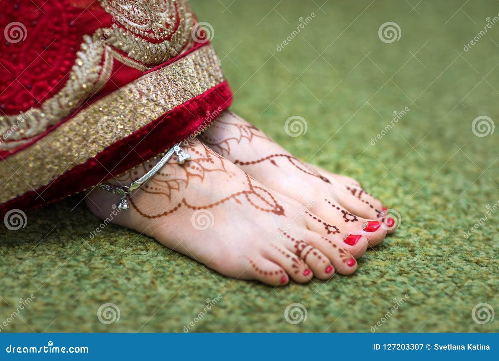 Indian Mehndi Painting On The Foot Feet Girls