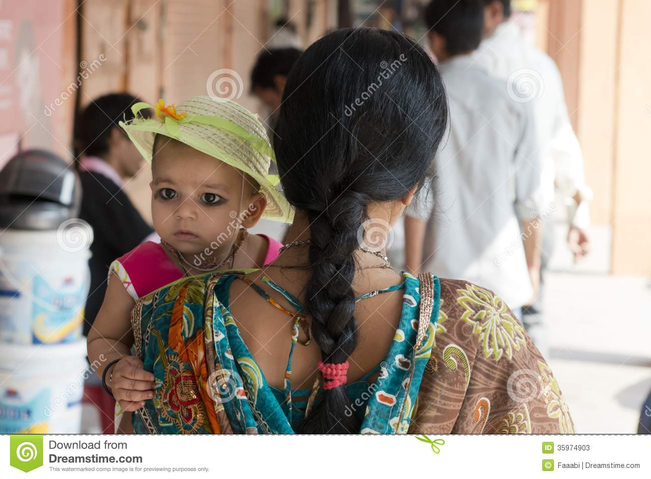 Indian Mom Holding Her Daughter On Her Arm