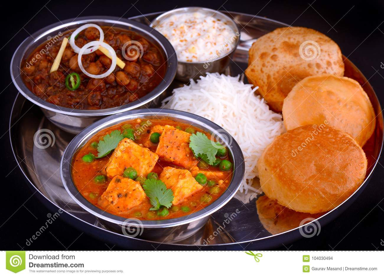 Indian punjabi meal curries served with rice and puri stock photo royalty free stock photo forumfinder Choice Image