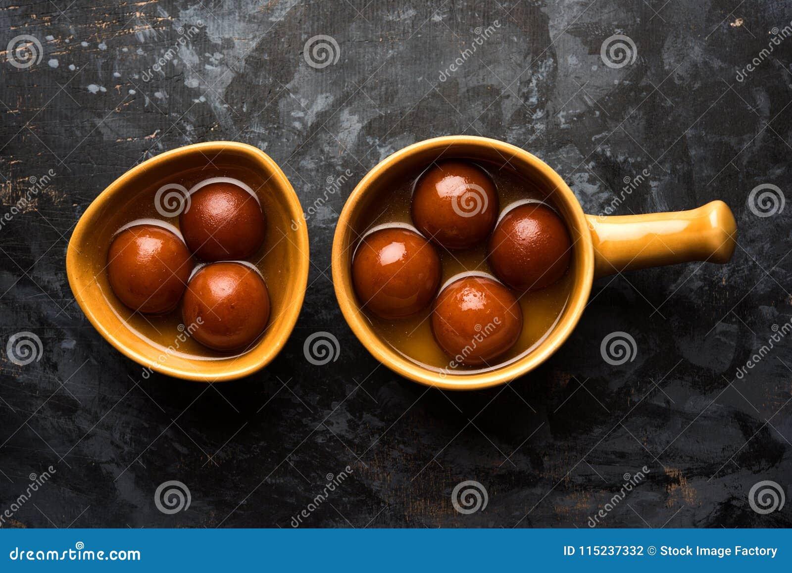 Indian sweet Gulab Jamun served in a ceramic bowl, selective focus