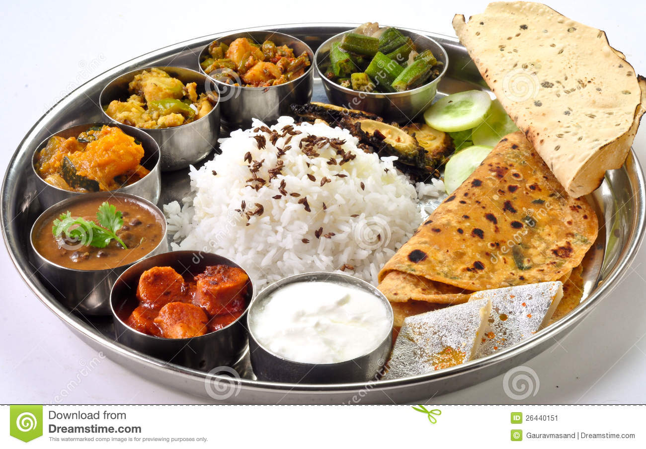 Indian meal Thali consisting of different curry,flat bread,rice and