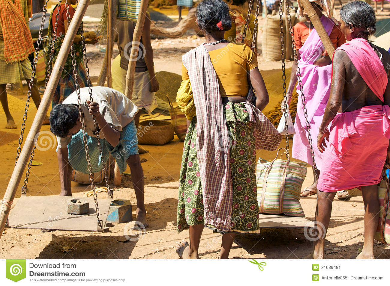 indian rural marketing India: the weekly market is the economic istitution in the rural area on which tribal farmers depend for their women in the indian rural area market india, orissa: women with traditional dress in the indian rural area market.