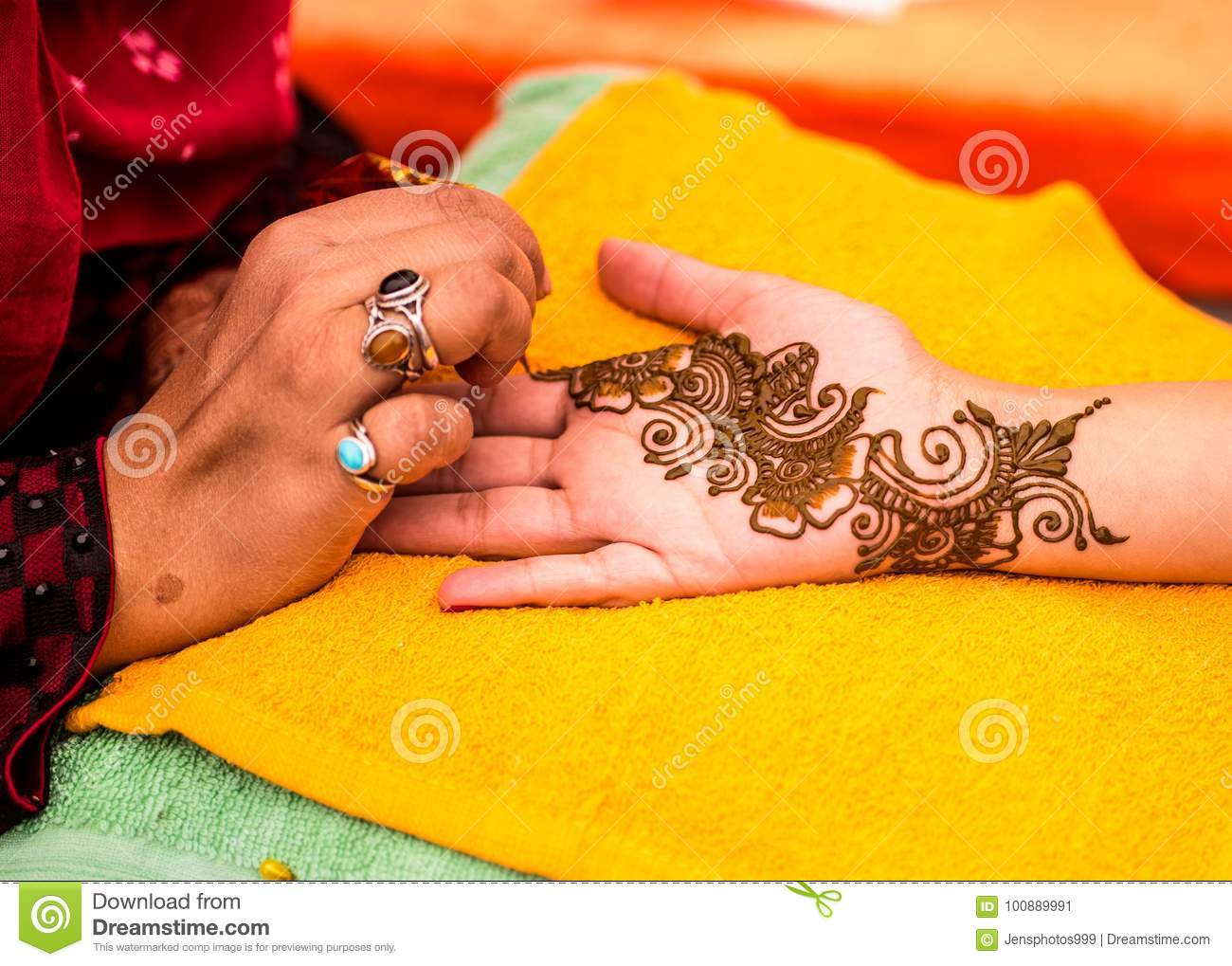 Henna Mehndi Vector Free Download : Indian wedding guest having mehndi applied to palm of hand