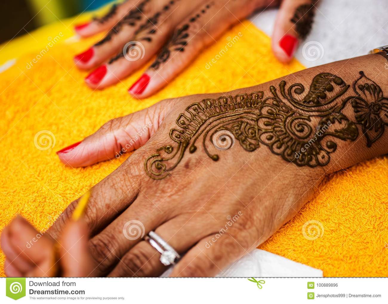 Indian Wedding Guest Having Mehndi Applied Traditional Henna Art