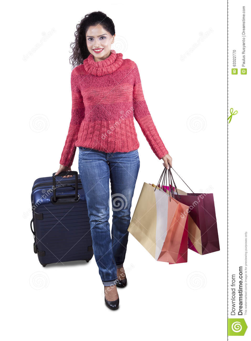 Wonderful Young Woman Wearing Cap And Coat Holding Shopping Bags Stock Photo