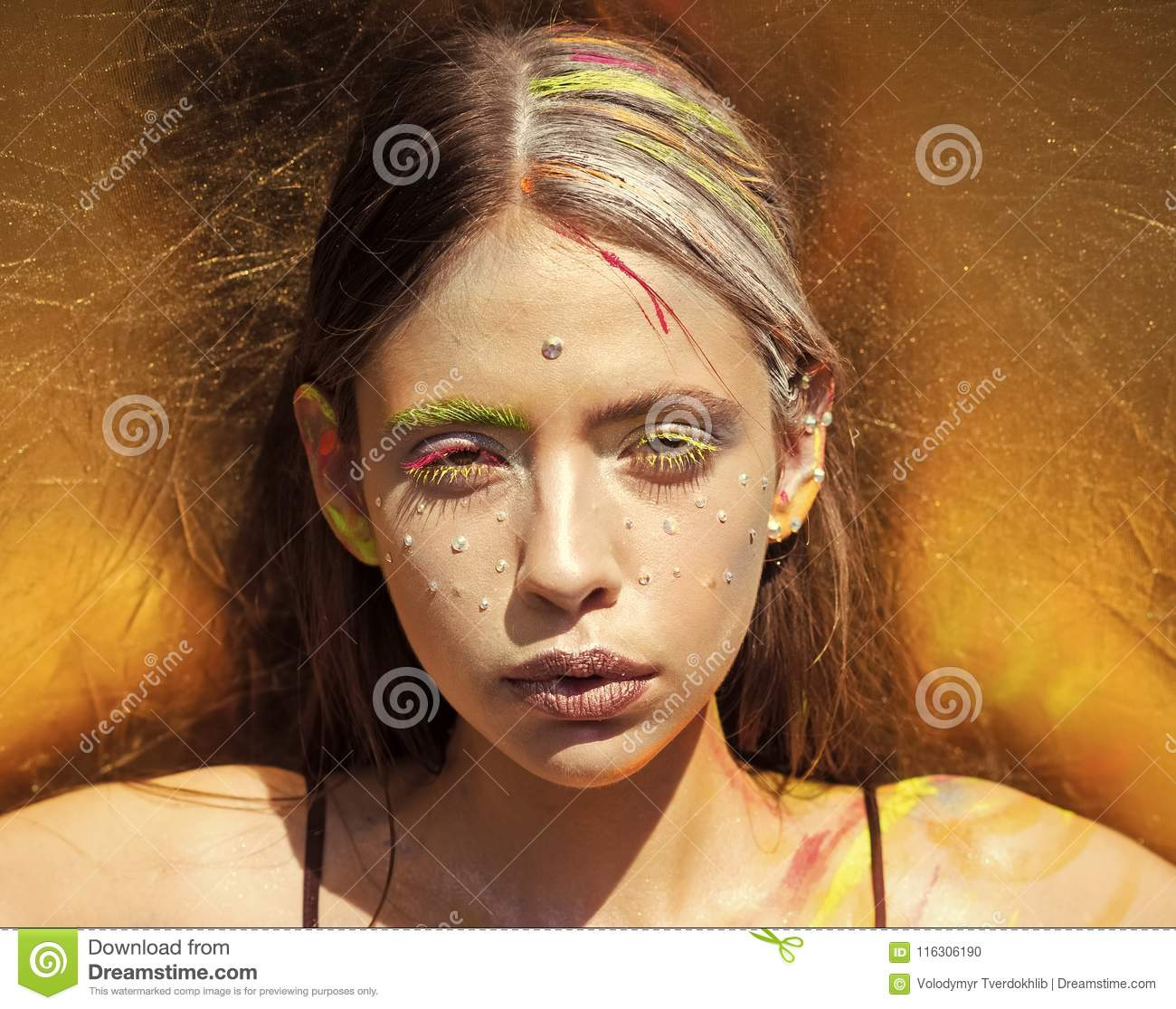 Indian woman with colorful neon paint makeup face