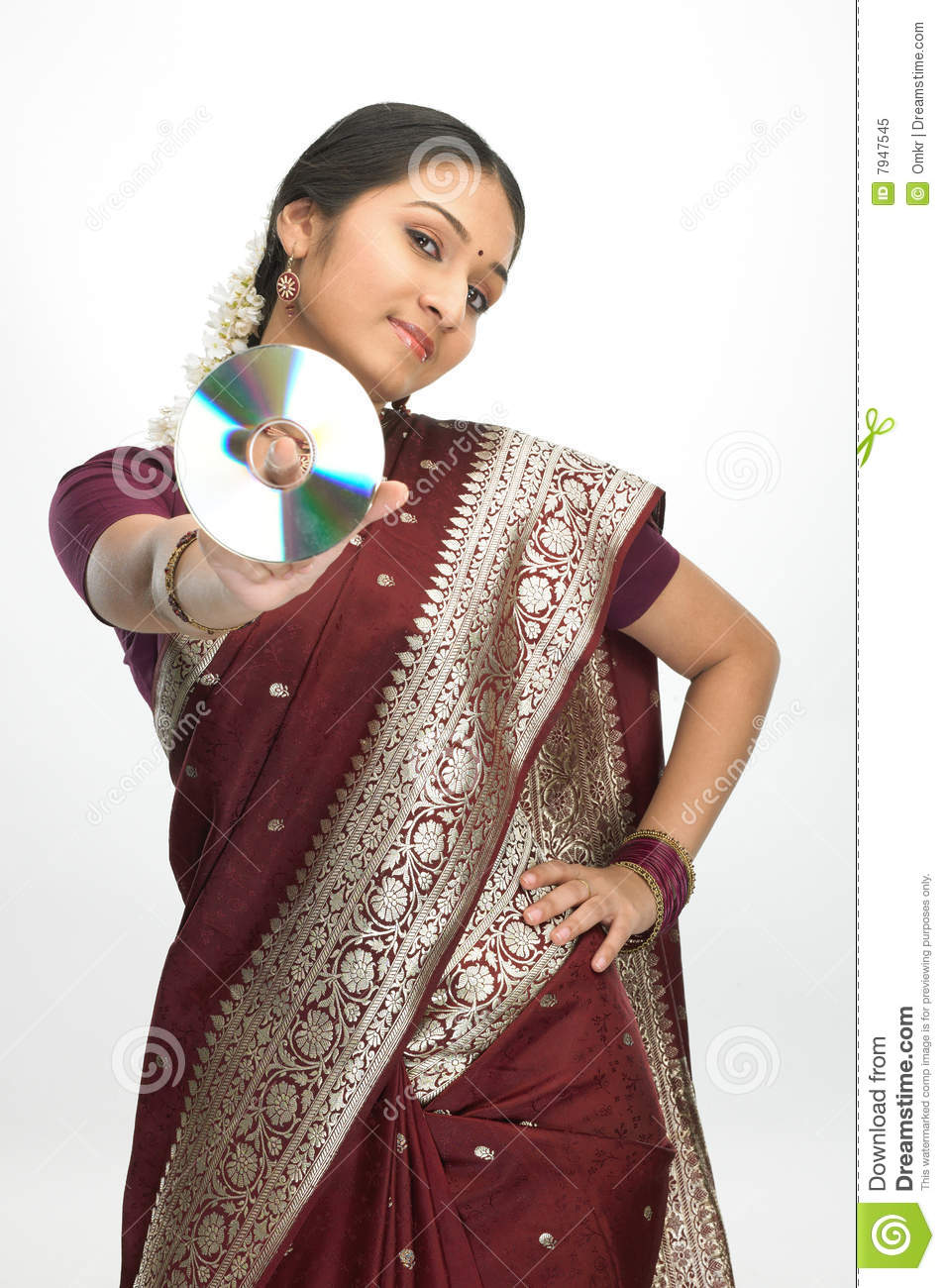 Indian Woman In Silk Sari Holding Cd Royalty Free Stock