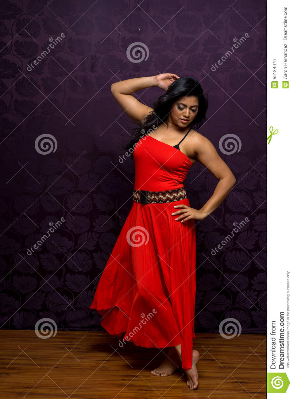 c8f5d77105 Indian female wearing a beautifl and vibrant flowing sleeveless dress. More  similar stock images