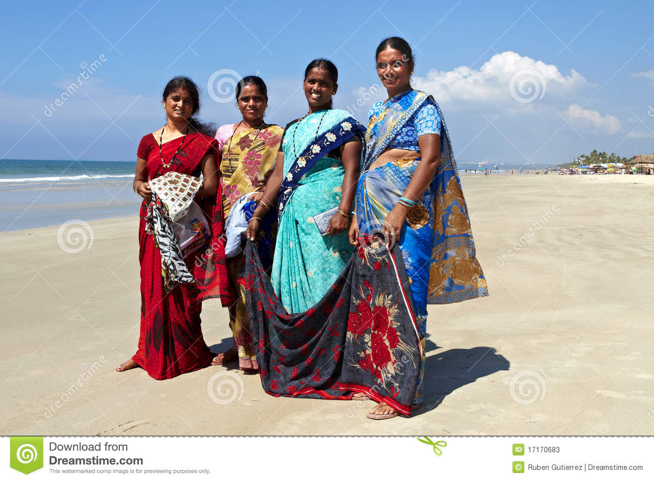 Indian women selling clothes to tourist in a beach of goa state.image ...