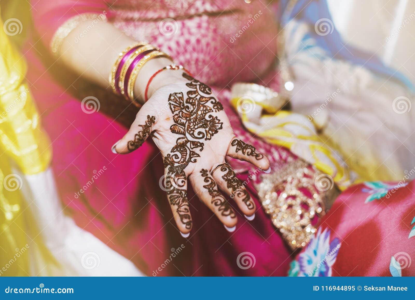 Indian Women Showing Beautiful Art Henna Mehndi Design On Hand Stock