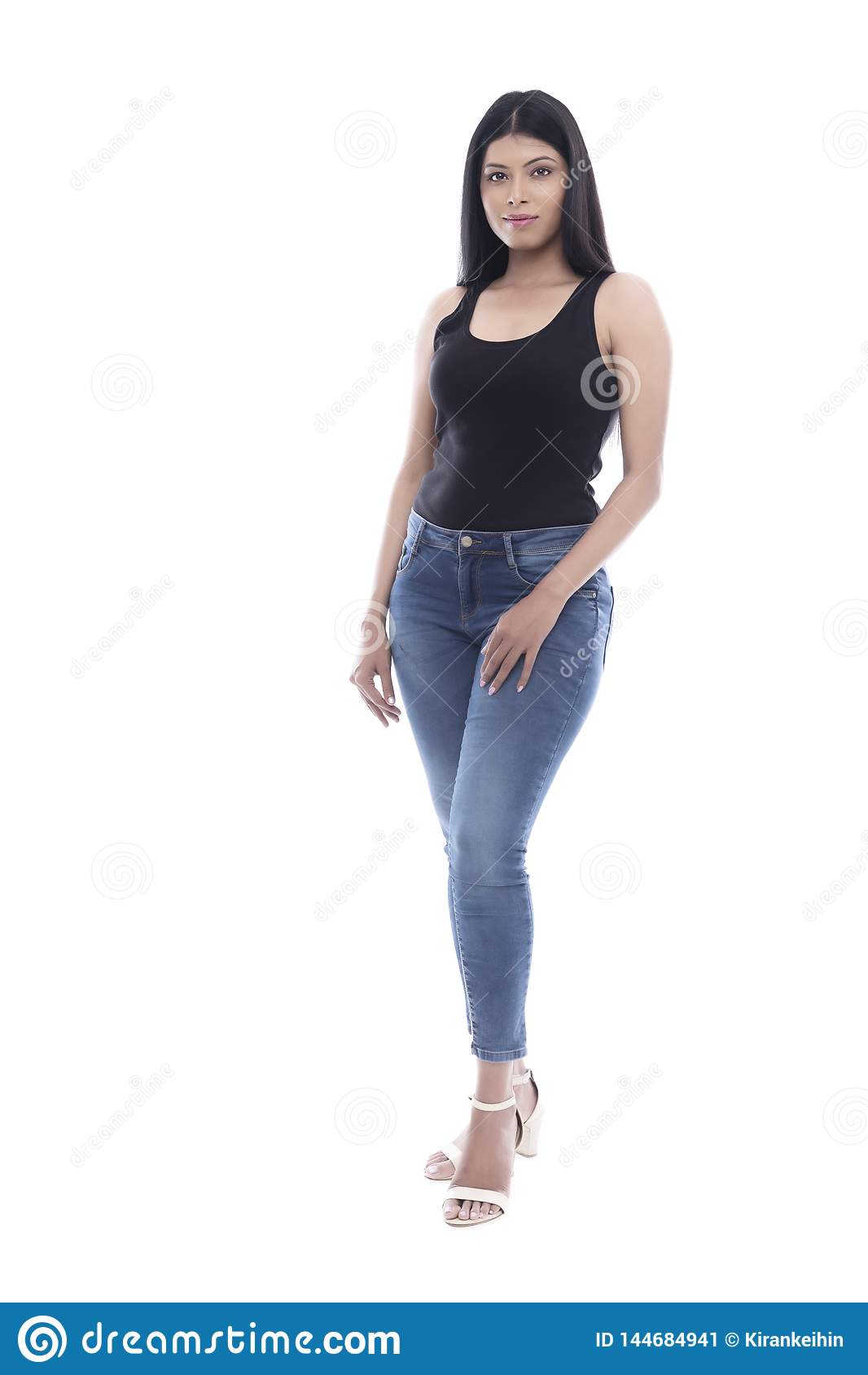 Indian Young girl in blue jeans and black camisole