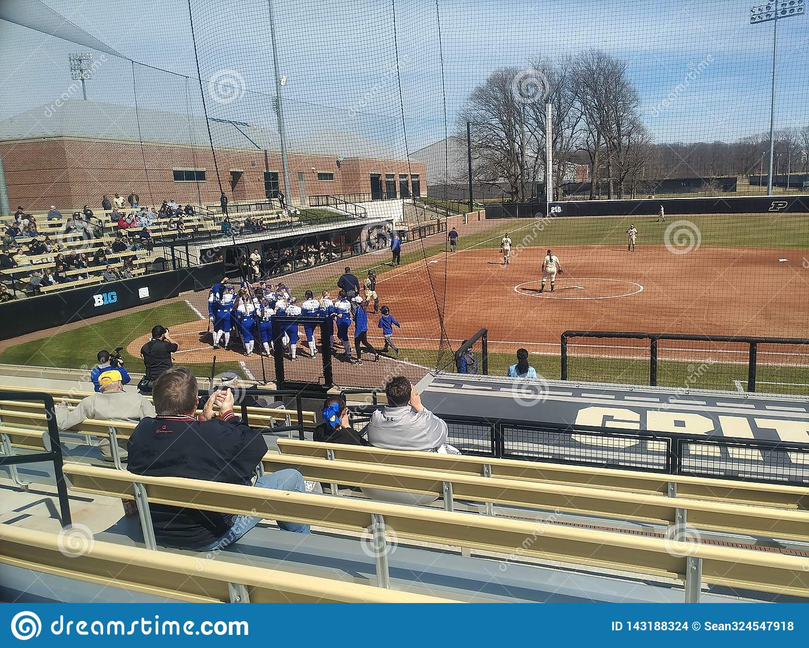 Indiana state players greet teammate at home plate