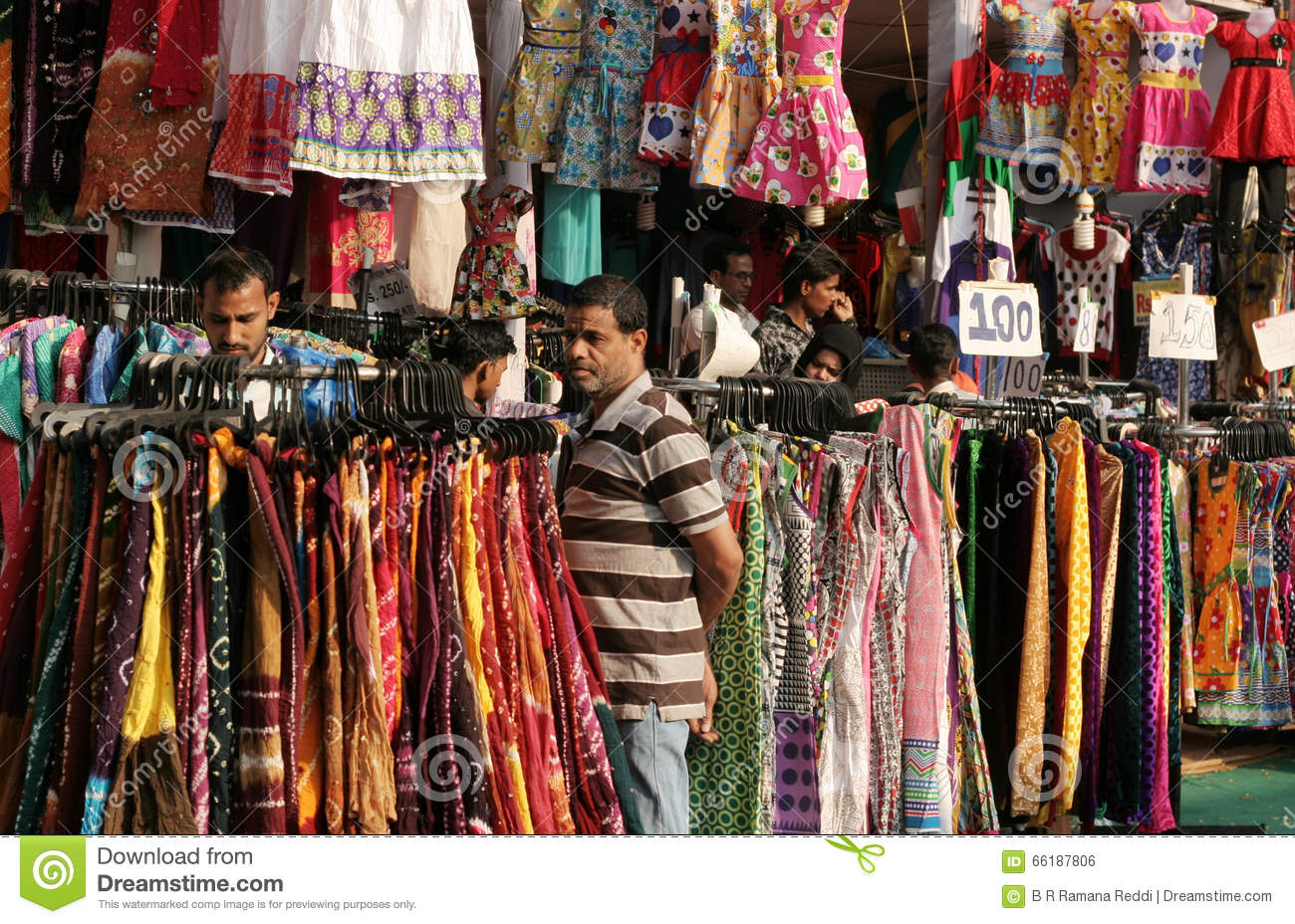 71552524 Indians shopping in road side clothes shop during an annual exhibition  event on February 4,2016 in Hyderabad,India.Common scene in India.