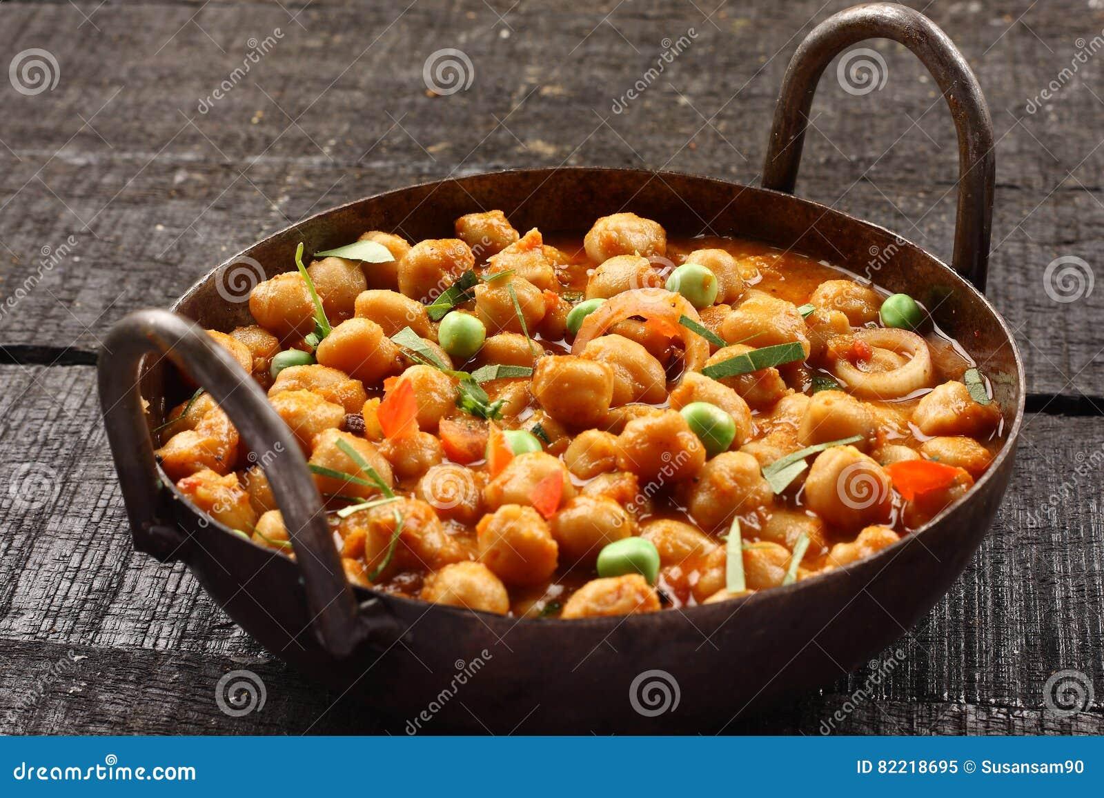 Indische Küche-würzige Kichererbsen Chola Masala Stockbild - Bild ...